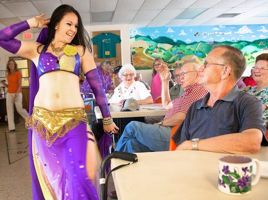 """Harlyn Laughman, right, and Milton Myers, middle, celebrates Father's Day with belly dancer Danelle Bender at Windy Hill Senior Center on Thursday, June 13, Spring Grove. """"Last time I saw a belly dancer was 60 years ago,"""" said Myers. DAILY RECORD / SUNDAY NEWS - SONYA PACLOBHarlyn Laughman, right, and Milton Myers, middle, celebrates Father's Day with belly dancer Danelle Bender at Windy Hill Senior Center on Thursday, June 13, Spring Grove. """"Last time I saw a belly dancer was 60 years ago,"""" said Myers. DAILY RECORD / SUNDAY NEWS - SONYA PACLOB"""