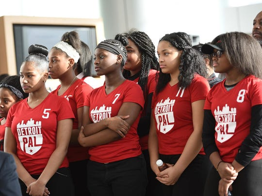"""Detroit Police Athletic League volleyball team members listen to speakers during an announcement of $12 million in contributions to the PAL """"Kids at the Corner"""" campaign on Tuesday."""