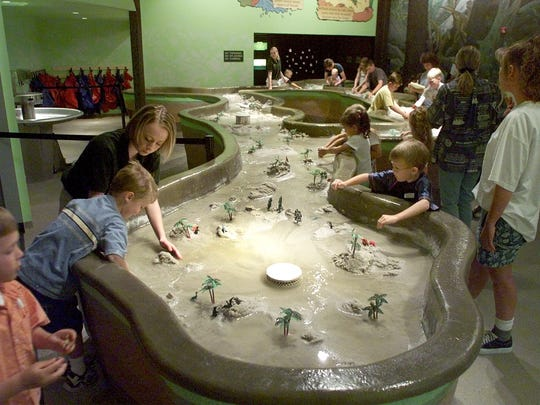 Children play in the  Erosion Table at the North American Museum of Ancient Life at Thanksgiving Point in 2015. A membership helps give the gift of a year of dinosaurs, science, planetariums or children's museums, writes Erin Stewart.