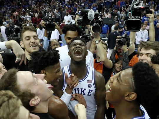 Duke's Zion Williamson, middle, and teammates celebrate a 73-63 victory against Florida State in the championship game of the ACC Tournament at Spectrum Center in Charlotte, N.C., on Saturday, March 16, 2019. (Streeter Lecka/Getty Images/TNS) **FOR USE WITH THIS STORY ONLY**