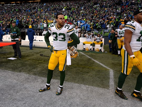 Micah Hyde stands in disbelief after the Green Bay Packers' 28-22 overtime loss to the Seahawks in the NFC championship game at CenturyLink Field in Seattle.