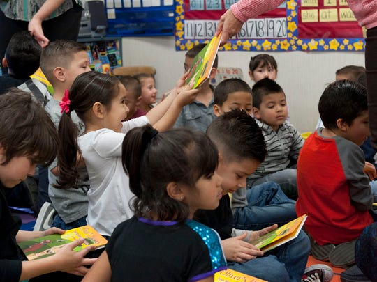 """Crestwood kindergartners receive copies of """"Oliver's Heroes: The Spider Adventures"""" by Cheryl Smith on Tuesday, March 3, 2015. Smith is also a Tulare County public defender."""