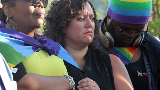From left, Vanessa Green, Brooke Mallory and Andrue Finley comfort one another during a candlelight vigil in Nyack to remember the victims of the Orlando mass shooting.