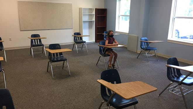 Typical individual classrooms at Epiphany School of Global Studies will have 10 to 12 students, socially distanced, as demonstrated by Emma James, class of 2028.