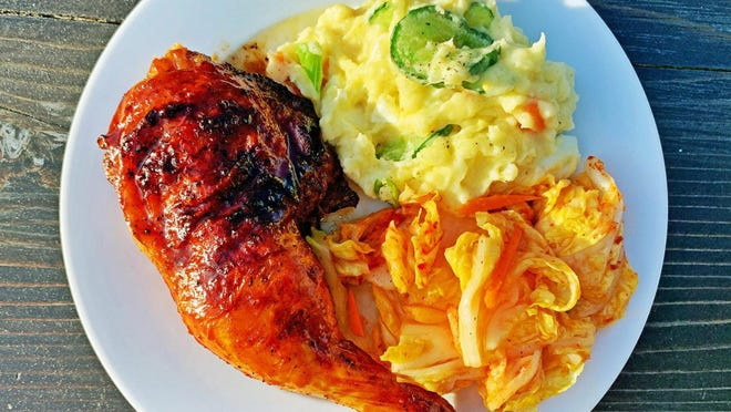 Gochujang-glazed grilled chicken with potato salad and kimchi.