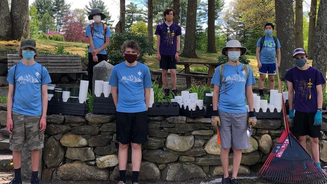 Boy Scouts of Acton Troop 1 volunteer at Woodlawn Cemetery. Pictured, from left, back row: Steven Tan, Sean Ryan and Thomas Knight. Front row: Will Atherton, Owen Pierce, Jonathan Lei and Thomas Crowley.