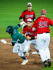 Parkside first baseman Grant Burleson (3) is caught in a pickle against Colonel Richard during the Bayside Championship on Wednesday, May 11 at Arthur W. Perdue Stadium in Salisbury.