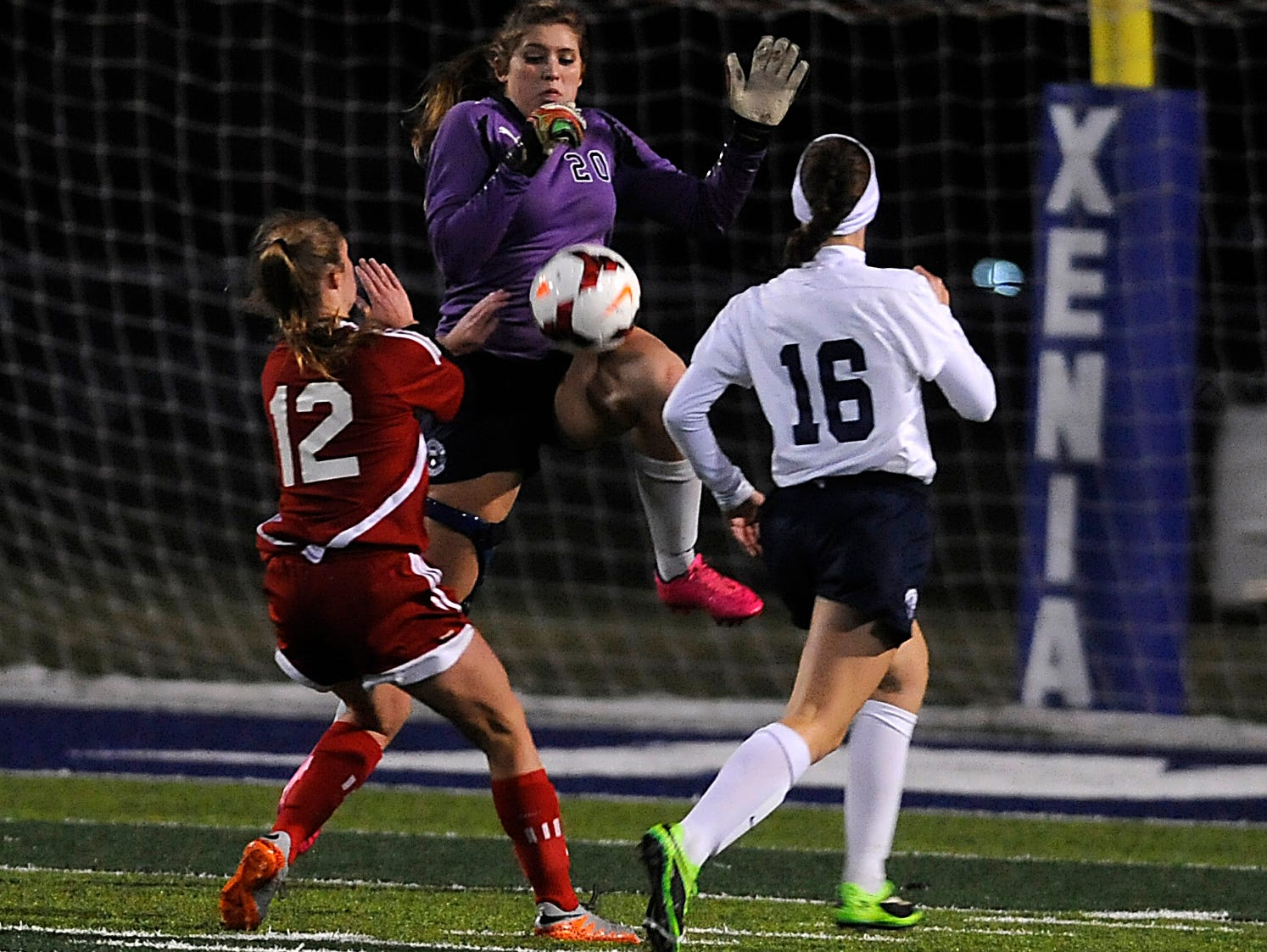 Granville goalkeeper Tori Long blocks a shot from Indian Hill Anna Podojil as defender Emily Kauchak recovers back. Long battled through injuries to help secure Granville's spot in the Division II State Championship with ten saves. They play number one Akron Hoban for the title Friday.
