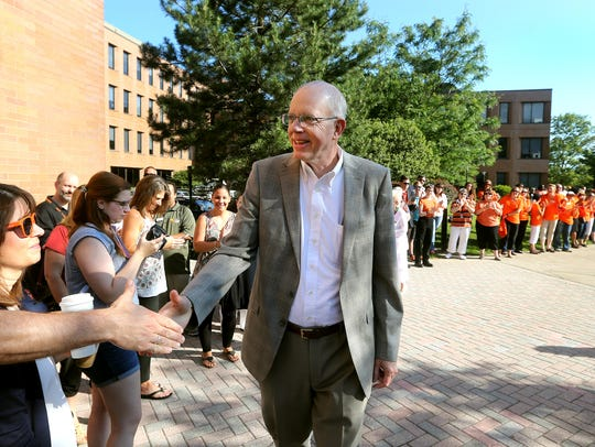 New RIT President David Munson was greeted by faculty