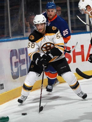 UNIONDALE, NY - SEPTEMBER 12:  Carter Camper #58 of the Boston Bruins skates against the New York Islanders during a rookie game exhibition at Nassau Coliseum on September 12, 2011 in Uniondale, New York. The Bruins defeated the Islanders 8-5.  (Photo by Bruce Bennett/Getty Images) *** Local Caption *** Carter Camper