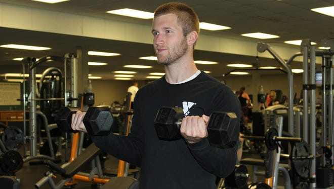 Start with the palms out holding a pair of dumbbells and curl the weights up to chest.