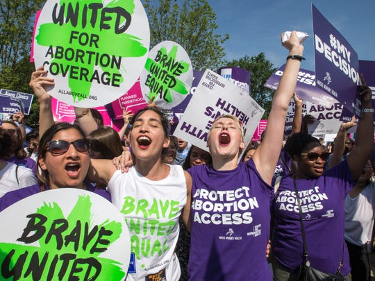 In a Monday, June 27, 2016 file photo, abortion rights activists, from left, Ravina Daphtary of Philadelphia, Morgan Hopkins of Boston, and Alison Turkos of New York City, rejoice in front of the Supreme Court in Washington, as the justices struck down the strict Texas anti-abortion restriction law known as HB2. Even as the 2016 election outcome intensifies America's abortion debate, a comprehensive new survey released Tuesday, Jan. 17, 2017 by the Guttmacher Institute finds the annual number of abortions in the U.S has dropped to well under 1 million, the lowest level since 1974.