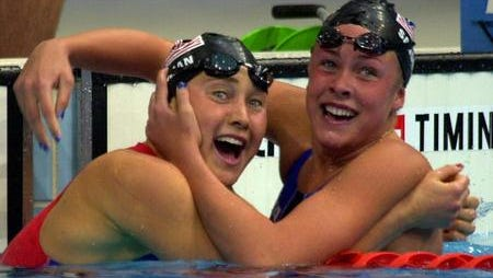 Misty Hyman, left, celebrating her gold medal-winning swim in the 200-meter butterfly at the 2000 Sydney Olympics with U.S. teammate Kaitlin Sandeno.