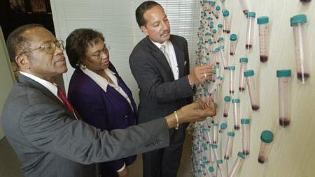 Fred Gray, left, Francis Smiley, center, and Robert Davis look at an exhibit on the Tuskegee Syphilis Study at the Tuskegee Human  and Civil Rights Multicultural Center. Vials representing  blood from each of the syphilis study participants with names written on them hang from the wall at the center.Mickey Welsh / Staff