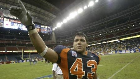 UTEP linebacker Robert Rodriguez acknowledged the crowd of Miner fans at Reliant Stadium as he tried to hold back tears after losing to Colorado in the EV1.net Houston Bowl in 2004.  Photo by Mark Lambie