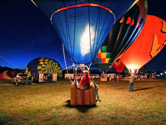 Roger Clark of Greer, pilot of The Sun Catcher, sits in his hot-air balloon for a balloon glow during Balloons Over Anderson October 1, 2014.