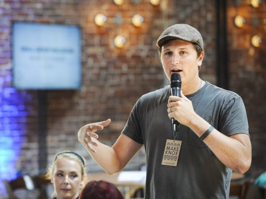 Garrett Thomson of Dogwood Arts presents ideas to local entrepreneurs during the Knoxville Maker City Summit on Sept. 19, 2016 at the Mill and Mine.