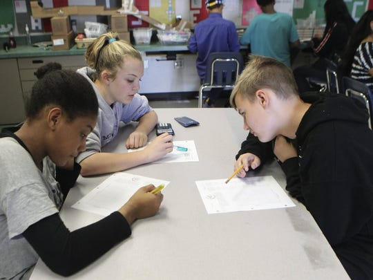 Mistletoe honor students Jocelyn Stewart (from left), Olivia Keyser and Andrew Stripling, all 13, work on proportional reasoning during their math class Tuesday, February 16, 2016 at the Redding school.