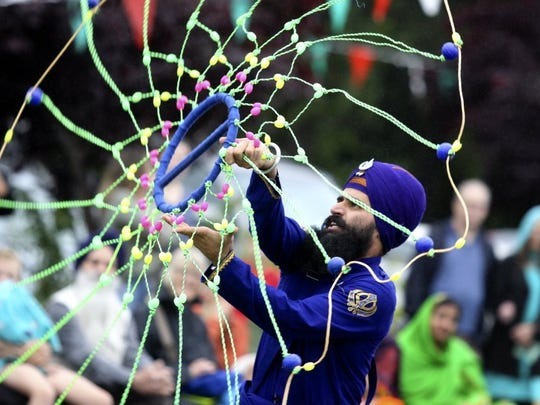 Didar Singh performs at a Sikh martial arts show, known as Gatka, during the 2016 Vaisakhi Festival and Day for Non-Violence at the Anderson Sikh Centre.
