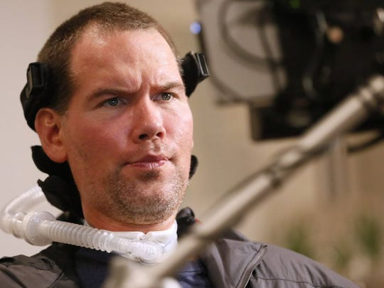 In this Monday, Jan. 18, 2016, photo, former New Orleans Saints NFL football player Steve Gleason uses eye-tracking technology to communicate an answer during an interview in New Orleans. ìGLEASON,î a feature-length documentary that gives an unfiltered look at his life with ALS premieres at the Sundance Film Festival on Saturday. (AP Photo/Jonathan Bachman)