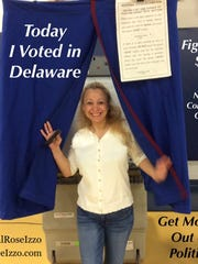 Rose Izzo is seen leaving a voting booth in this photo