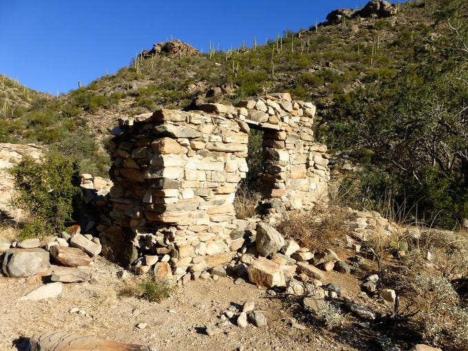 The ruins of an old stone line shack are found along