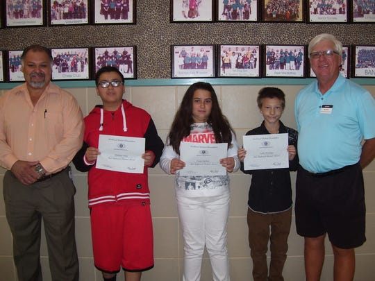 From left to right, Principal Moises Cardiel, Matthew Ortiz, Carin Gardner, Colby Brundage, and Ned Kline (Kiwanis) recognize these student's as the this months most improved at Mountain View Middle School
