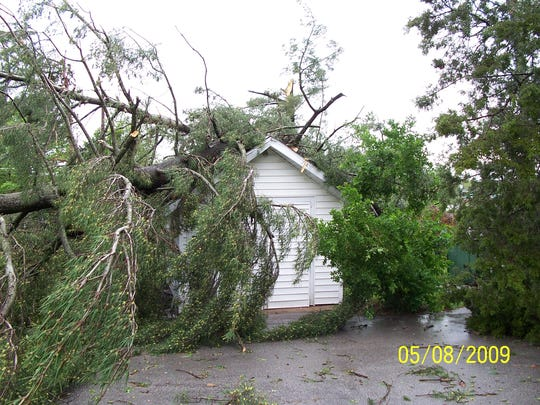 """90-mph """"derecho"""" storm winds toppled trees onto homes during the May 2009 event in Missouri."""