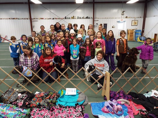 "In early February, 46 Girl Scouts of all ages, from Merrill, Wausau, Rhinelander, White Lake, Schofield, Weston and Rothschild, celebrated the 28th anniversary of the ""Love-a-Pet"" Girl Scout service event at the Maplecreek Dog Training Center."