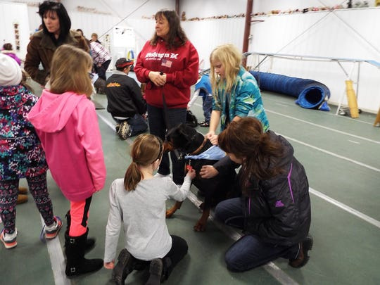 The Girl Scouts spent the morning listening to educational presentations from a variety of speakers, including the New Life Pet Adoption Center, the Maplecreek Therapy Group, several professional dog trainers on agility and instruction, as well as some very special guests with their dog rescued from Aruba, and a bulldog rescued from a puppy mill.