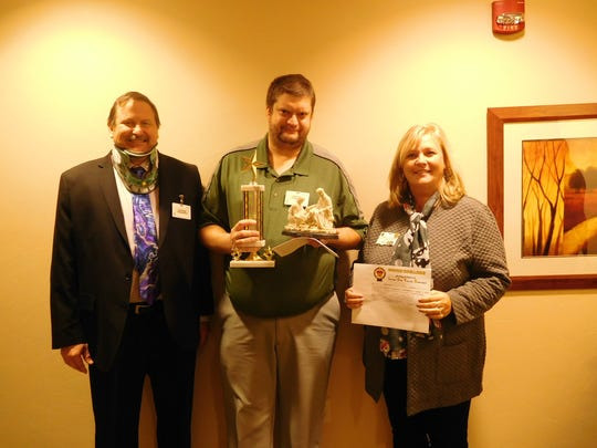 Network administrator Rick Sroka was chosen as the Service Excellence Star Award recipient for November at Felician Village in Manitowoc. Pictured, from left, areFrank Soltys, Felician Villagepresident and CEO;Rick Sroka, Service Excellence Award winner;and Brenda Georgenson, director of quality at Felician Village.