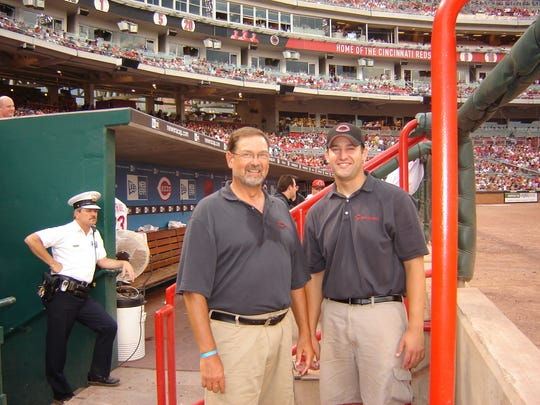Nick Elam with his dad, who was serving as a guest grounds crew member with the Cincinnati Reds in August 2006.