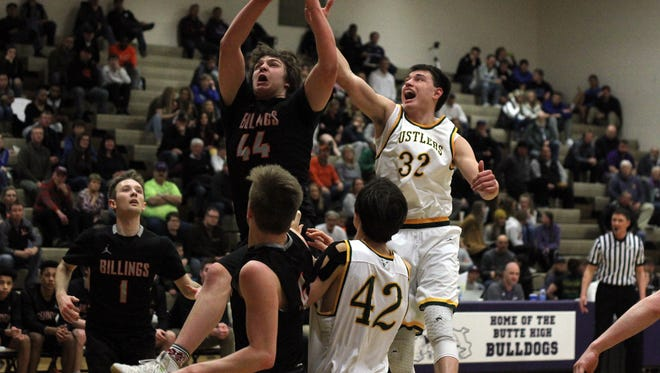 Bryce Depping of CMR defends against Billings Senior Friday night during Eastern AA semifinal play at Butte High