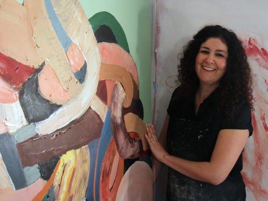 Artist Samantha Palmieri at work in the studio of her
