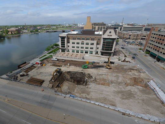 A wide view of the Metreau apartments complex site shows its location on the banks of the Fox River between Nicolet Bank and the northwest corner of Washington and Walnut Streets in downtown Green Bay. Dermond Property Investments has started site work on the complex with excavation crews using heavy machinery for lower level ground work at the site.