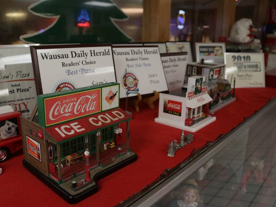 Customers have recognized Sam's food with a number of best-of awards. Owner John Huber is also a Coke memoriabilia collector.