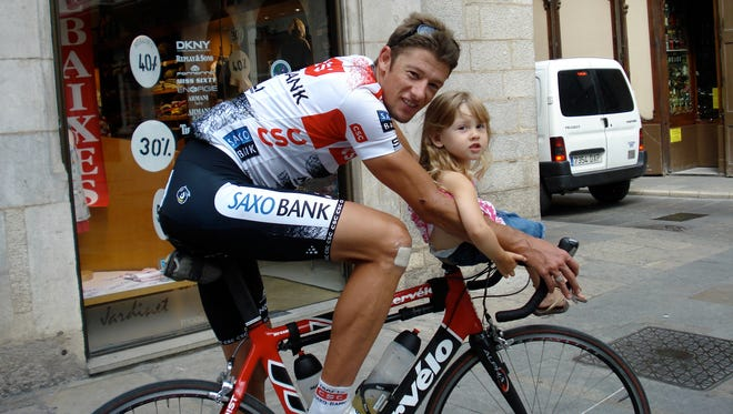 Olympic Cyclist Jason McCartney poses with his daughter, Ginger, in Girona, Spain.
