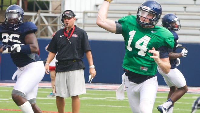 Bo Wallace throws during practice Saturday