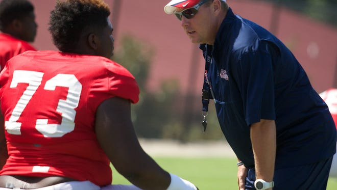 Hugh Freeze encourages Rod Taylor at practice on Wednesday August 20.