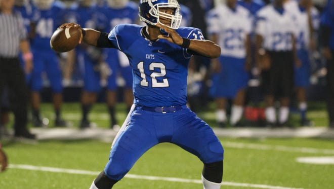 Meridian quarterback J-mar Smith drops back to pass during the first half of the Brandon vs Meridian game in Meridian,MS.