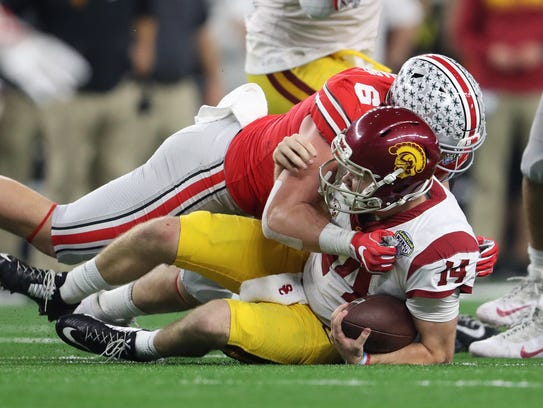 Ohio State's Sam Hubbard records one of the eight sacks