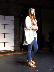 Community Christian 8th-grader Anna Maguire performs an original monologue.