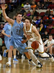 CMR's Kyle Byrne (11) dribbles around Kyle Winkler of Great Falls (23) in the fourth quarter of the second round of the Class AA state basketball tournament at Rimrock Auto Arena at MetraPark on Friday, March 9, 2018.