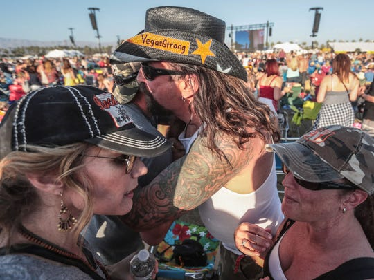 Billy Pulaski, center, and his wife, Jennifer, left, greet Sue Heili, right, and survivors of the 2017 Route 91 Harvest festival mass shooting in Las Vegas.