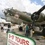 Aviation fans inspect a historic visiting aircraft at one of the Yankee Air Museum's annual air shows.<137>A view of people checking out the Yankee Air Show at Willow Run Airport in Belleville, Saturday August 9, 2008. MADALYN RUGGIERO/Special to the News<137>