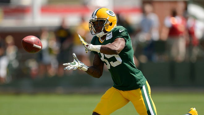Packers cornerback Demetri Goodson (39) makes a catch while running drills during training camp practice at Ray Nitschke Field.