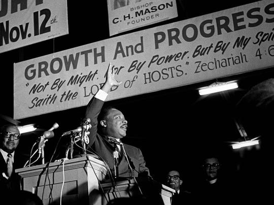 "Dr. Martin Luther King Jr., who was on a tour of the South to recruit volunteers for his ""Poor People's Campaign"", spoke to an overflow crowd at Mason Temple March 18, 1968. Crowd estimates ranged from 9,000-13,000. Speaking in support of striking sanitation workers, King called for a general work stoppage by black Memphians if the city did not agree to a union dues checkoff. ""Along with wages and other securities, you're struggling for the right to organize. This is the way to gain power. Don't go back to work until all your demands are met"", Dr. King told the crowd. He pledged to return to Memphis on March 22 to lead a march that was postponed because of a near record snowfall. The protest was rescheduled for March 28. The march ended in disorder with looting and vandalism along Beale and Main Streets. Police moved in with tear gas and nightsticks. By day's end, one person had been killed and more than 60 injured. King would agonize over what happened and vowed to return to lead a peaceful mass march. On Wednesday, April 3, King again returned to Memphis. That night, more than 2,000 listened as he gave his famous ""Mountaintop"" speech at Mason Temple. The next day, at 6:01p.m., an assassin's bullet struck Dr. King as he stood on the balcony outside room 306 at the Lorraine Motel. King would have celebrated his 84th birthday Thursday, Jan. 15, 2013. Memphis is celebrating the life of the civil rights leader today with prayers, a parade and other celebrations. REFER KING EVENTS (Photo by Vernon Matthews / The Commercial Appeal)"