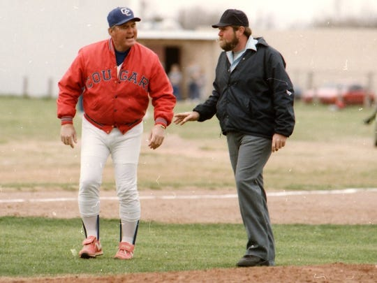 Cooper coach Andy Malone, left, argues a call with an umpire during a game in 1987.