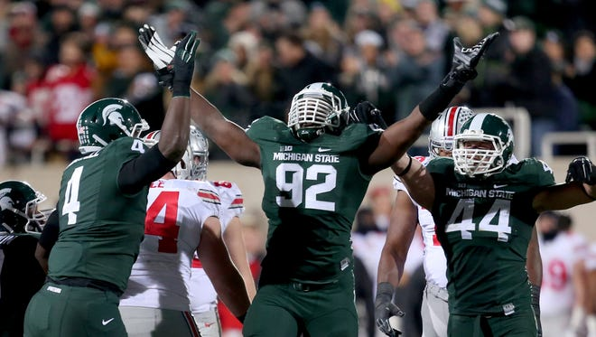 Michigan State's Joel Heath sacks Ohio State's J.T. Barrett during the first quarter on Nov. 8 in East Lansing.