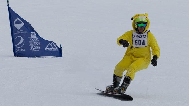 """Shasta High's Dylan Wakeland wins the boys snowboard race Monday in the traditional """"dress up day"""" at the CNISSF Division 1 championships at Mt. Shasta Ski Park. Wakeland tied for second in the league standings."""
